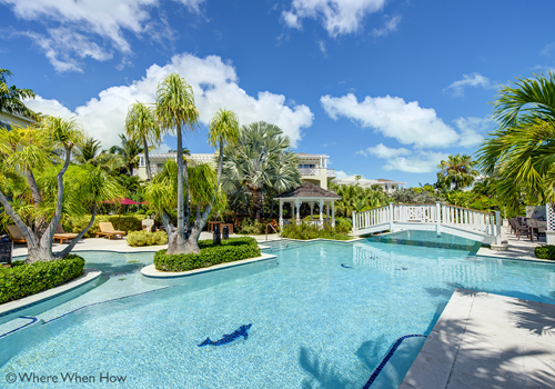 A photograph of the Royal West Indies Resort on Grace Bay Beach, Providenciales (Provo), Turks and Caicos Islands.