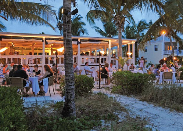 A photograph of the beachfront dining at Bay Bistro on Grace Bay Beach, Providenciales (Provo), Turks and Caicos Islands.