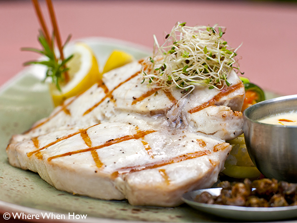 A photograph of Chef Paul Newman's fresh Grilled Wahoo, Providenciales (Provo), Turks and Caicos Islands.