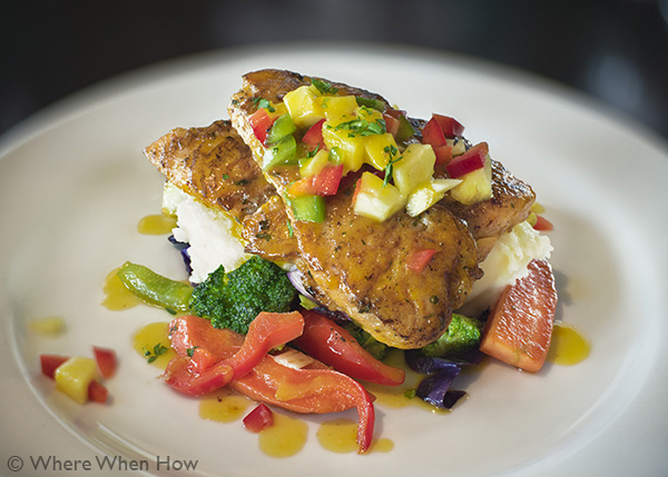 A photograph of Grilled Grouper Filet in Mango Butter Sauce at Fresh Catch Restaurant at The Saltmills, Providenciales (Provo), Turks and Caicos Islands.