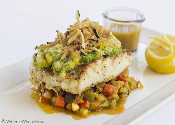 A photograph of Grilled TCI Grouper with shrimp topping and pumpkin sauce.Grace's Cottage, Grace Bay, Providenciales (Provo), Turks and Caicos Islands.