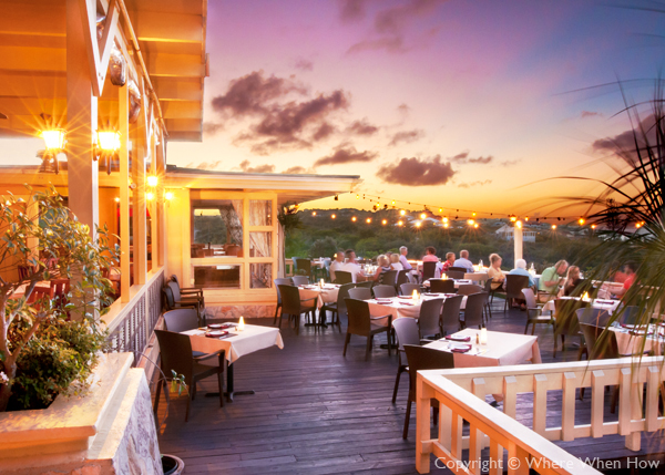 A photograph of Magnolia Restaurant & Wine Bar overlooking Turtle Cove, Providenciales (Provo), Turks and Caicos Islands.