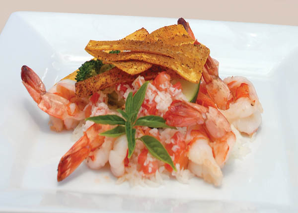 A photograph of Grilled Tiger Shrimp with Tomato and Coconut Salsa at Magnolia Restaurant & Wine Bar, Turtle Cove, Providenciales (Provo), Turks and Caicos Islands.