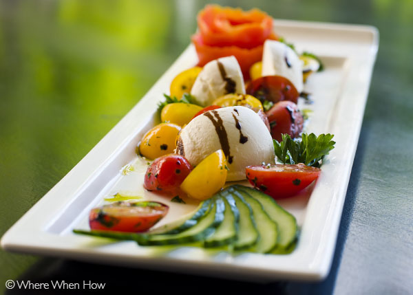 A photograph of Heirloom Tomato salad with Burrata cheese and Nicoise olives at The Somerset, Grace Bay, Providenciales (Provo), Turks and Caicos Islands.