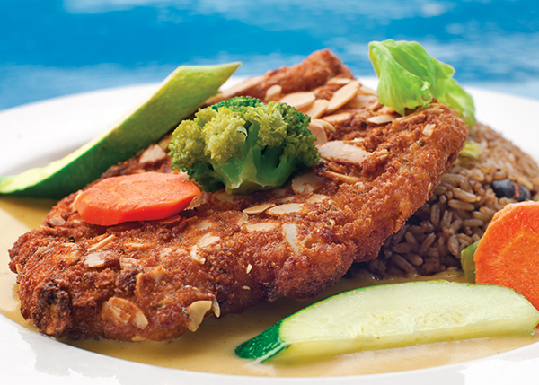 A photograph of The Sharkbite's Signature Dish is their Almond Encrusted Grouper at Turtle Cove Marina, Turtle Cove, Providenciales (Provo), Turks and Caicos Islands.