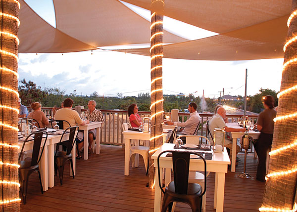 A photograph of the second level dining deck at Via Veneto, Ports of Call, Grace Bay, Providenciales (Provo), Turks and Caicos Islands.