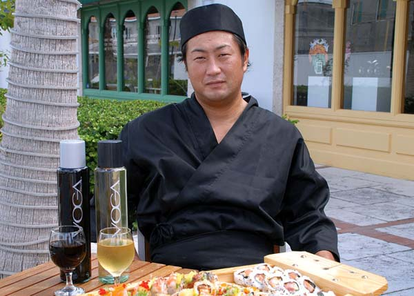 A photograph of Executive Chef and owner Yoshi Ono at Yoshis Japanese Restaurant, Providenciales (Provo), Turks and Caicos Islands.