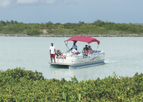 A photograph of Pontoon boating, kayaking on Chalk Sound, Providenciales (Provo), Turks and Caicos Islands.