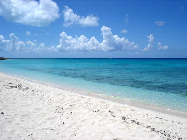 A photograph of beautiful, deserted beach on Providenciales (Provo), Turks and Caicos Islands, British West Indies
