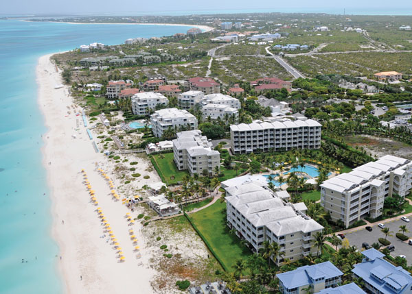 A photograph of Flying over the resorts on Grace Bay in Turks and Caicos Islands