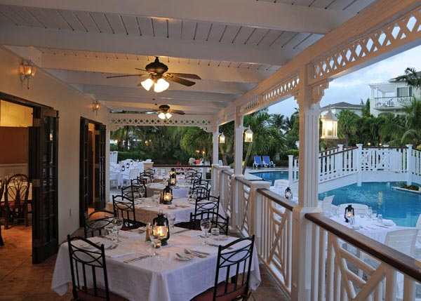 A photograph of the poolside dining at Pelican Bay Restaurant & Bar, Royal West Indies Resort, Providenciales (Provo), Turks and Caicos Islands.