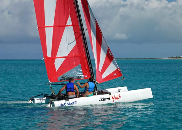 A photograph of a hobie cat sailing across Grace Bay, Providenciales (Provo), Turks and Caicos Islands