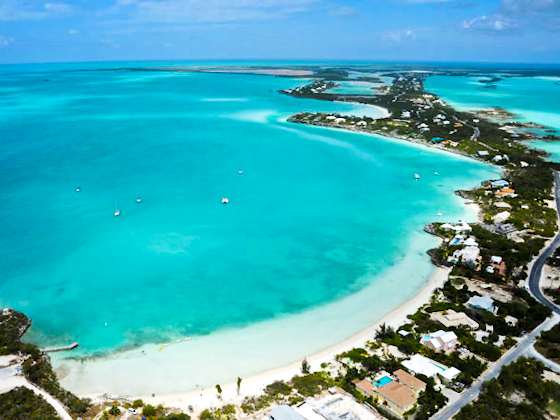 An aerial photograph of Sapodilla Bay Beach, Providenciales (Provo), Turks and Caicos Islands, British West Indies
