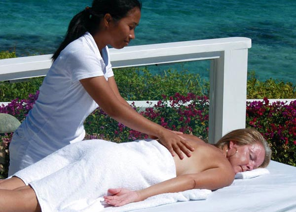 A photograph of a lady having a Spa Tropique massage on Providenciales (Provo), Turks and Caicos Islands