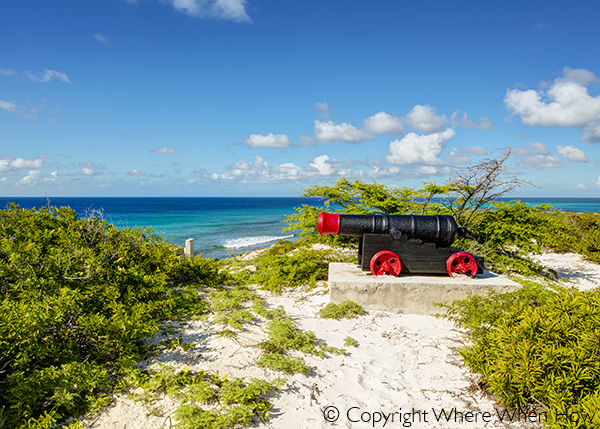 A photograph of a canon overlooking the east coast of Salt Cay, Turks and Caicos Islands, British West Indies