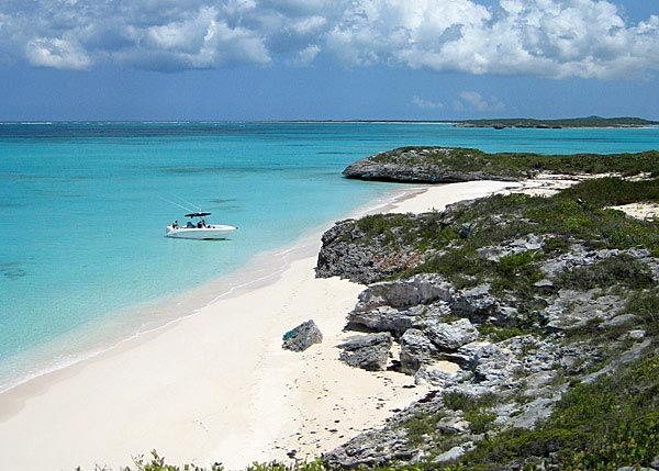 A photograph of a remote and pristine beach on Joe Grant Cay, Turks and Caicos Islands.